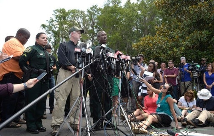 Nick Wiley, executive director of the Florida Fish & Wildlife Conservation Commission, left, and Orange County Sheriff Jerry Demings answer questions from reporters during a news conference Wednesday, June 15, 2016, in Lake Buena Vista, Fla., after a toddler was dragged into the lake Tuesday evening by an alligator outside Disney's Grand Floridian Resort & Spa. (AP Photo/Phelan M. Ebenhack)