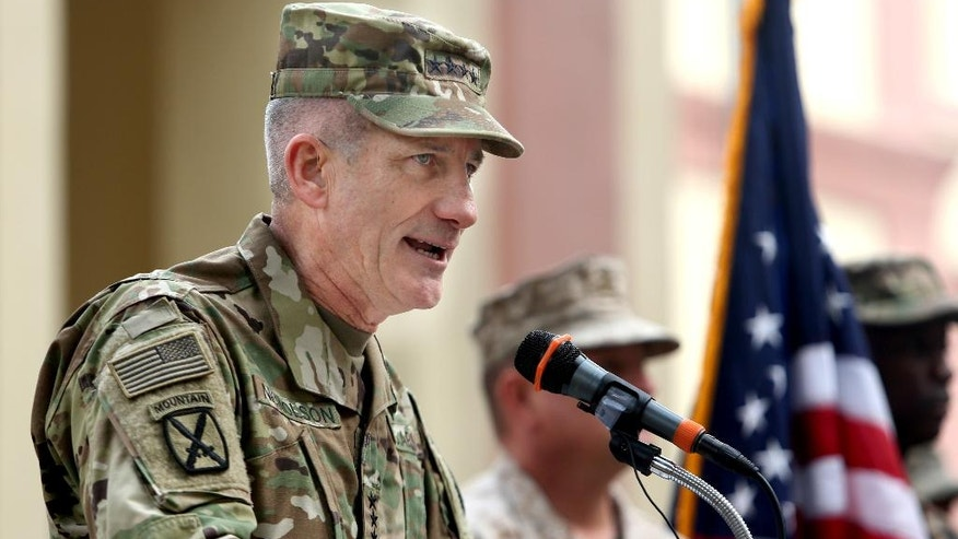In this Wednesday, March 2, 2016 photo, New U.S. commander in Afghanistan, U.S. Army Gen. John W. Nicholson, speaks during a change of command ceremony at the Resolute Support Headquarters in Kabul, Afghanistan. The new U.S. commander in Afghanistan has submitted his first three-month assessment of the situation in the war-torn country and what it's going to take to defeat the Taliban, a U.S. military official tells The Associated Press. (AP Photo/Rahmat Gul)