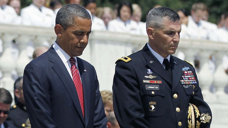 This May 28, 2012 file photo shows President Barack Obama standing with Maj. Gen. Michael S. Linnington, Commander of the U.S. Army Military District of Washington, during a Memorial Day wreath-laying ceremony at the Tomb of the Unknowns at Arlington National Cemetery in Arlington, Va.