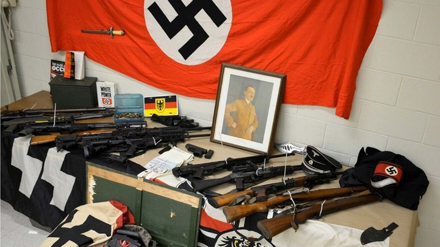 June 16, 2016: This image shows weapons and Nazi paraphernalia seized from a home in Mount Sinai, N.Y.
