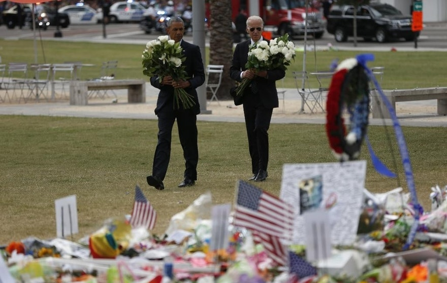 President Barack Obama and Vice President Joe Biden arrive to place flowers at a memorial in Orlando, Fla., Thursday, June 16, 2016, in honor of people killed in the shooting at a gay nightclub. (AP Photo/Pablo Martinez Monsivais)