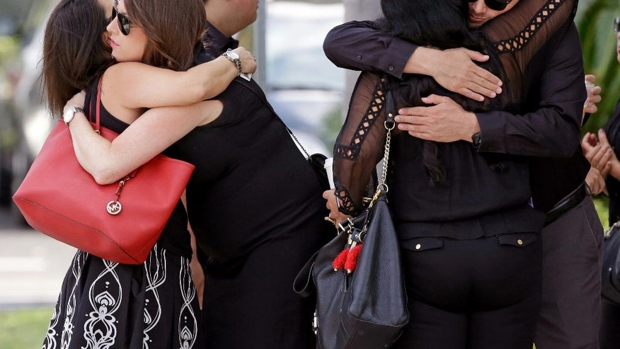Mourners embrace outside the funeral service for Anthony Luis Laureano Disla, one of the victims of the Pulse nightclub mass shooting, Friday, June 17, 2016, in Orlando, Fla. (AP Photo/John Raoux)