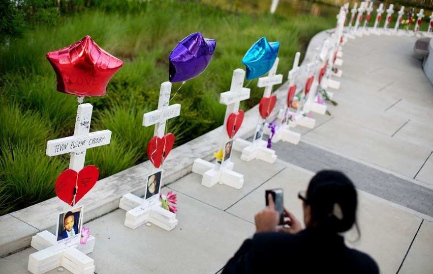 Crosses, one for each victim, line a walkway as a memorial to those killed in the Pulse nightclub mass shooting a few blocks from the club early Friday, June 17, 2016, in Orlando, Fla. (AP Photo/David Goldman)
