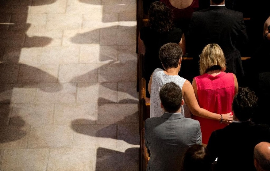 Mourners pray during the funeral service for Christopher Andrew Leinonen, one of the victims of the Pulse nightclub mass shooting, at the Cathedral Church of St. Luke Saturday, June 18, 2016, in Orlando, Fla. (AP Photo/David Goldman)