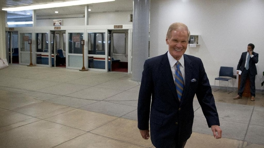 Sen. Bill Nelson, D-Fla., walks on Capitol Hill, Monday, June 20, 2016 in Washington.  A divided Senate hurtled Monday toward an election-year stalemate over curbing guns(AP Photo/Alex Brandon)