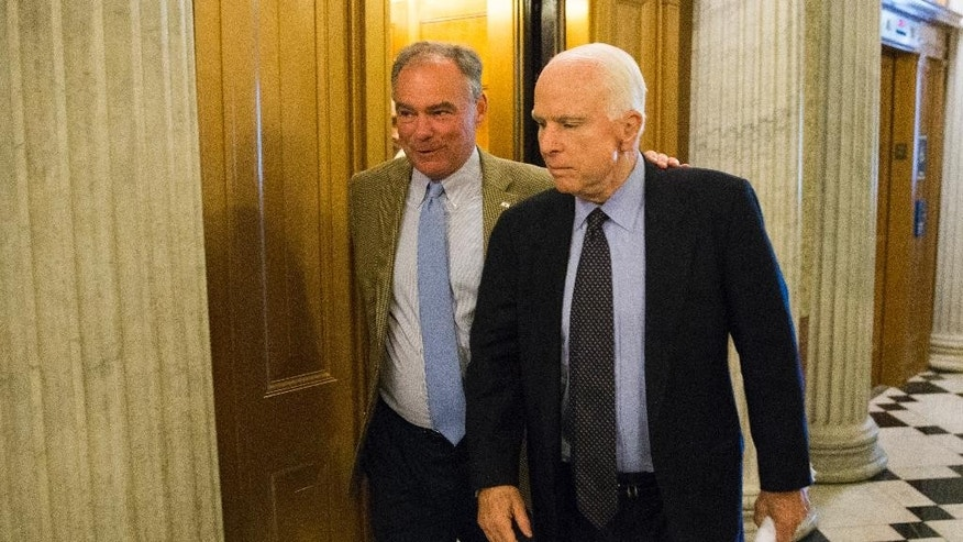 Sen. Tim Kaine, D-Va., left, talks with Sen. John McCain, R-Ariz., as they arrive for a vote on Capitol Hill, Monday, June 20, 2016, in Washington. A divided Senate hurtled Monday toward an election-year stalemate over curbing guns, eight days after Orlando's mass shooting horror intensified pressure on lawmakers to act but left them gridlocked anyway — even over restricting firearms for terrorists. (AP Photo/Evan Vucci)