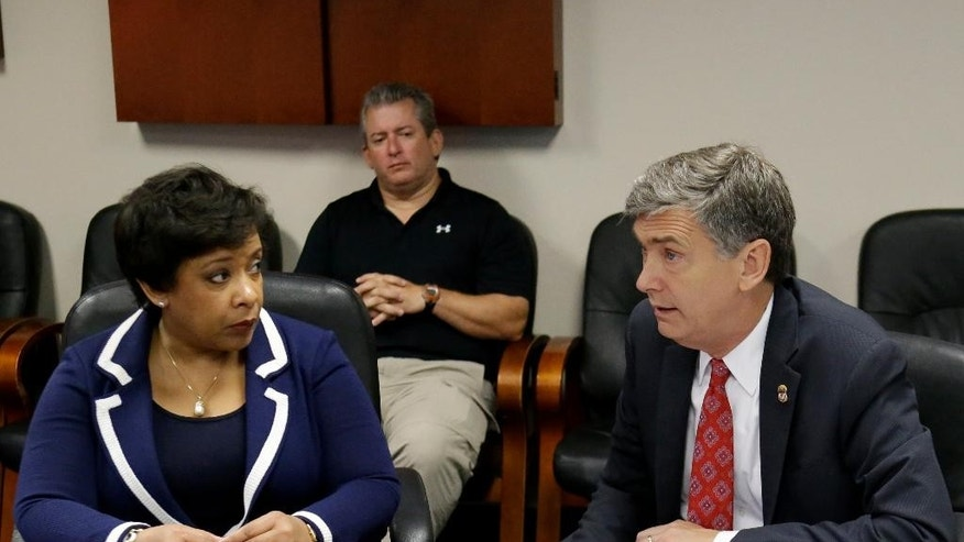 Attorney General Loretta Lynch, left, meets with U.S. Attorney Lee Bentley at the Orlando FBI office for a briefing on the Pulse nightclub mass shooting, Tuesday, June 21, 2016, in Orlando, Fla. (AP Photo/John Raoux)