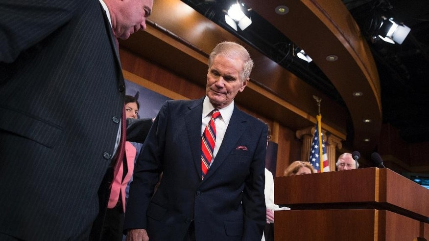 Sen. Bill Nelson, D-Fla. leaves the podium after speaking during a news conference on Capitol Hill in Washington, Tuesday, June 21, 2016, to unveil a new gun legislation proposal. Sen. Tim Kaine, D-Va. is at left. (AP Photo/Evan Vucci)