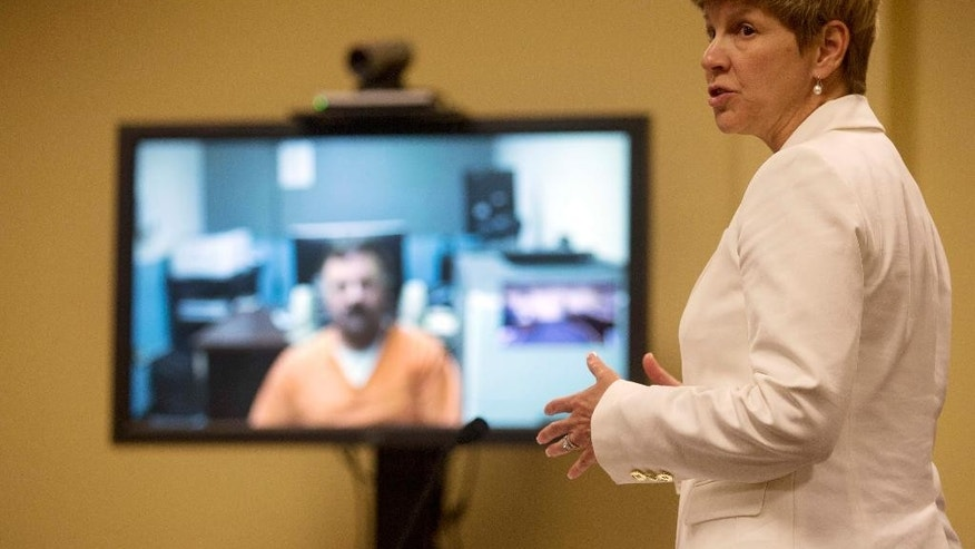 State Prosecutor Jane Young speaks during the video arraignment of Wendell Noyes, Tuesday June 21, 2016, in district court in Berlin, N.H.  Noyes is charged with second-degree murder in the death of 11-year-old Celina Cass. The girl was reported missing from her home July 26, 2011. Her body was recovered from the Connecticut River six days later. (AP Photo/Jim Cole, Pool)