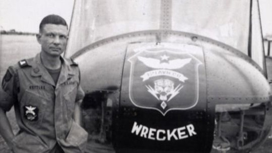 This 1969 photo shows Charles Kettles with an Army UH-1H helicopter in Vietnam