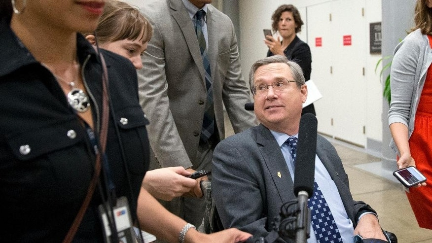 Sen. Mark Kirk, R-Ill., listens to a reporter's question on Capitol Hill, Monday, June 20, 2016 in Washington. A divided Senate hurtled Monday toward an election-year stalemate over curbing guns. (AP Photo/Alex Brandon)