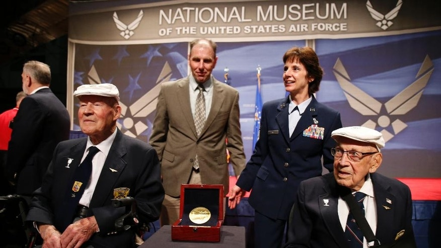 "FILE - In this April 18, 2015 file photo two members of the Doolittle Tokyo Raiders, Staff Sgt. David Thatcher, front left, and Lt. Col. Richard ""Dick"" Cole, right, pose for photos with Lt. Gen. John ""Jack"" Hudson, rear left, Director National Museum of the United States Air Force, and Air Force Material Commander Gen. Janet C. Wolfenbarger, after the Congressional Gold Medal to the Doolittle Tokyo Raiders was presented to the National Museum of the United States Air Force at Wright-Patterson Air Force Base, in Dayton, Ohio. Thatcher, one of the last two surviving members of the Doolittle Raiders, who bombed Japan in retaliation for the attack on Pearl Harbor, has died in Montana. He was 94. (AP Photo/Gary Landers,File)"