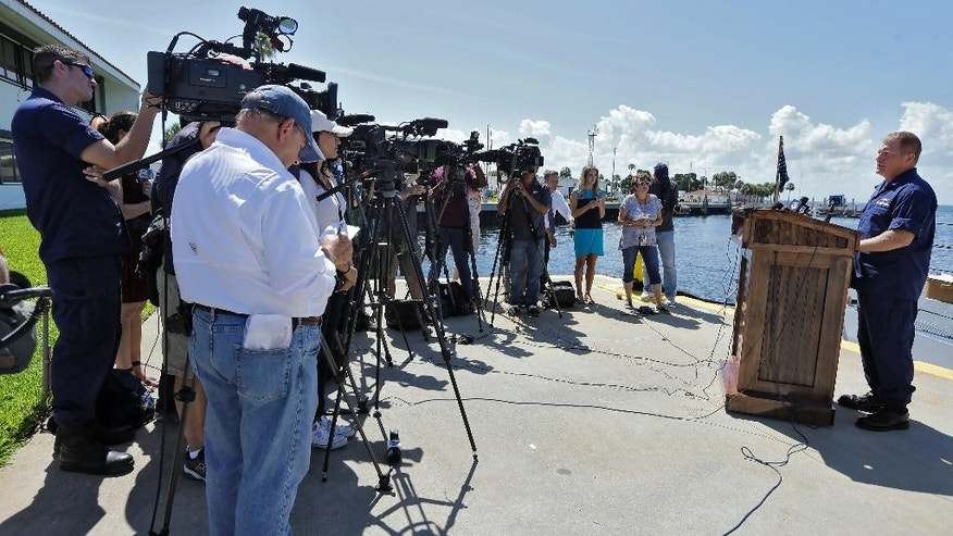 U.S. Coast Guard Capt., Gregory Case, right, speaks during a news conference regarding the missing family members Wednesday, June 22, 2016, in St. Petersburg, Fla. According to the Coast Guard Sector in St. Petersburg, a concerned family member stated that the missing family was last heard from Sunday morning when they left Sarasota, Fla., to sail to Fort Myers to repair the boat. AP Photo/Chris O'Meara)