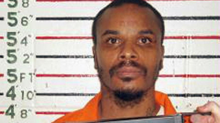 FILE - This undated booking photo released by Missouri Department of Corrections shows Carlin Q. Williams. A person who has seen a sealed document says DNA test results show that Williams, currently a Colorado inmate, is not Prince's son and therefore not entitled to inherit a fortune worth up to $300 million. (Missouri Department of Corrections via AP, File)