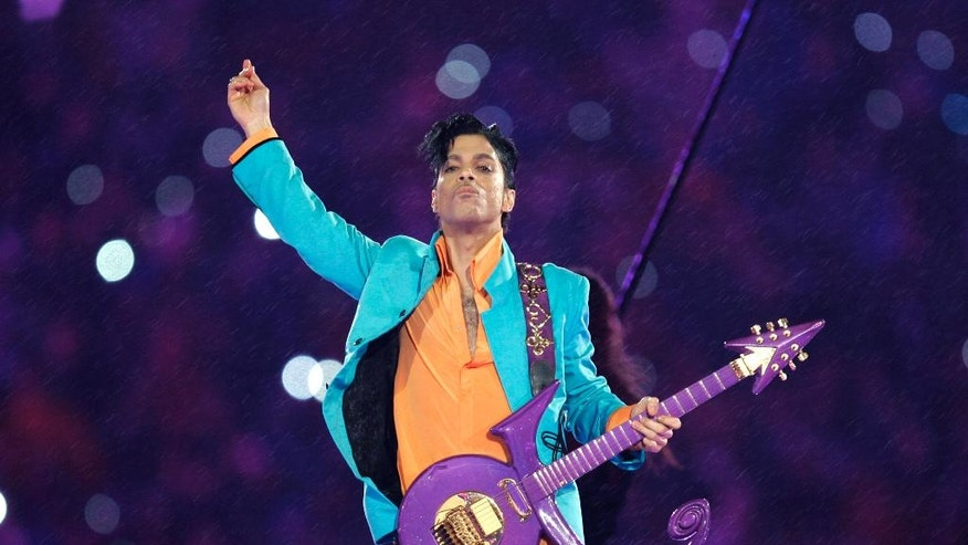 FILE - In this Feb. 4, 2007, file photo, Prince performs during the halftime show at the Super Bowl XLI football game at Dolphin Stadium in Miami. A person who has seen a sealed document says DNA test results show that Carlin Q. Williams, a Colorado prison inmate, is not Prince's son and therefore not entitled to inherit a fortune worth up to $300 million. (AP Photo/Chris O'Meara, File)