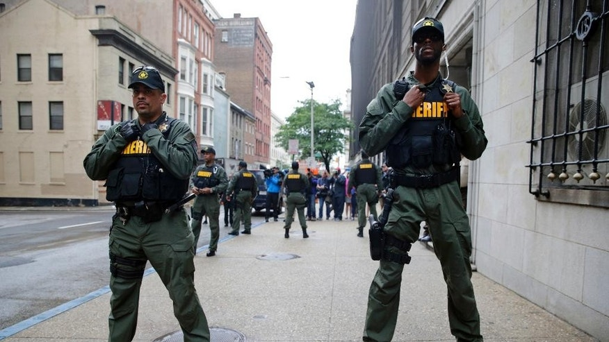 Members of the Baltimore City Sheriff''s Office stand guard outside a courthouse as they await the arrival of Officer Caesar Goodson, one of six Baltimore city police officers charged in connection to the death of Freddie Gray, in Baltimore, Thursday, June 23, 2016. (AP Photo/Patrick Semansky)