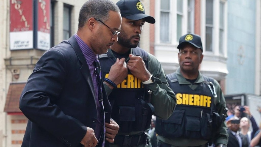 Officer Caesar Goodson, left, one of six Baltimore city police officers charged in connection to the death of Freddie Gray, arrives at a courthouse before receiving a verdict in his trial in Baltimore, Thursday, June 23, 2016. (AP Photo/Patrick Semansky)