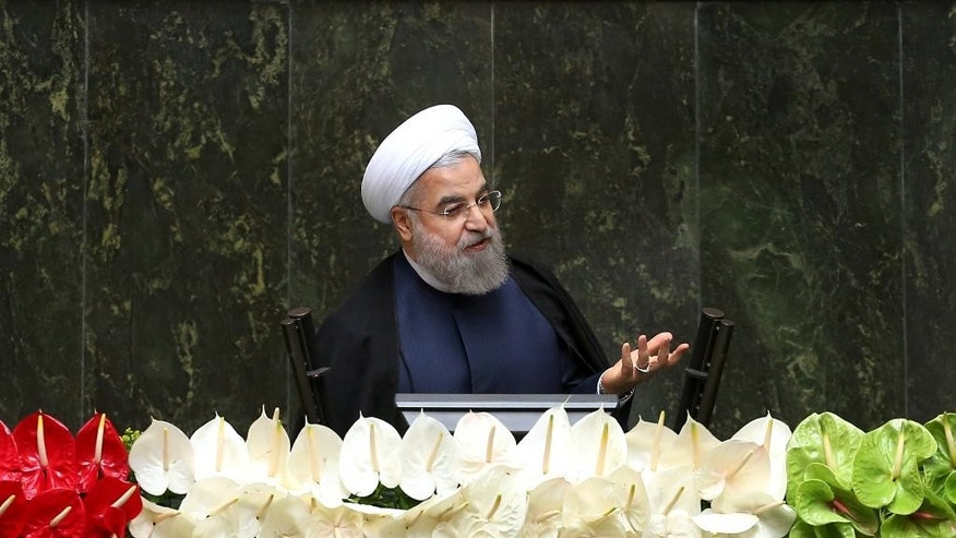 FILE - In this May 28, 2016 file photo, Iranian President Hassan Rouhani speaks during the inauguration of the new parliament, in Tehran, Iran. Boeing Co.'s historic deal with Iran Air rests on shaky foundations, with potentially $25 billion riding on hopes that Tehran would stop its past practice of using the airline's planes to ferry fighters and weapons across the Middle East.  (AP Photo/Ebrahim Noroozi, File)