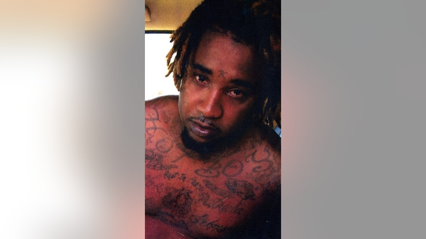 This photo provided by the Ouachita Parish Sheriff's Office shows Rickie Wade Jr., 28. Two northeast Louisiana sheriff's deputies were in stable condition Thursday, June 23, 2016, after being shot, by Wade, while serving arrest warrants. Wade was arrested after being flushed out of a house with tear gas, the sheriff said. (Ouachita Parish Sheriff's Office via AP)