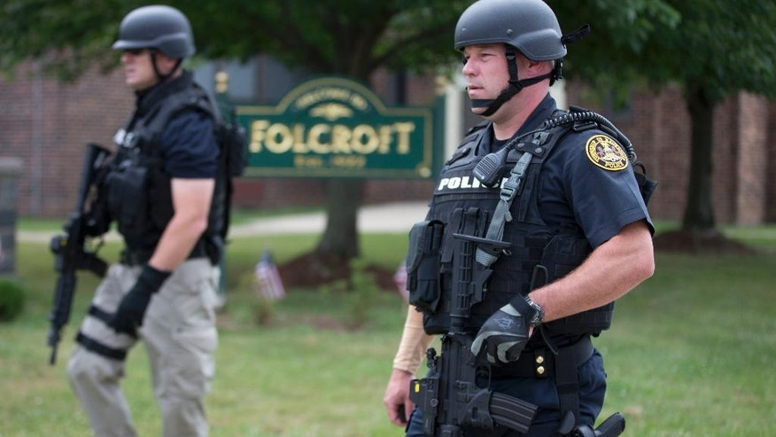Law enforcement gather in the aftermath of a shooting, Folcroft, Friday, June 24, 2016. Authorities are hunting for a suspect after a police officer was shot near Philadelphia. (AP Photo/Matt Rourke)