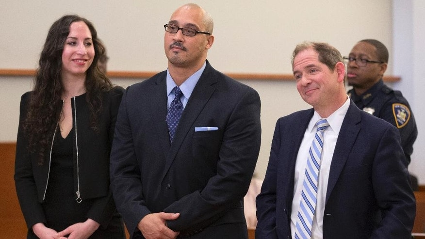FILE- In this March 23, 3016 file photo, Richard Rosario, center, and his lawyers Glenn Garber, right, and Rebecca Freedman, of the Exoneration Initiative, listen as a judge sitting in New York overturns Rosario's conviction. Rosario, who spent 20 years in prison for a killing he says happened while he was in Florida, asked a judge on Friday, June 24, 2016 to keep his case open so he could be fully vindicated. (AP Photo/Mary Altaffer, File)