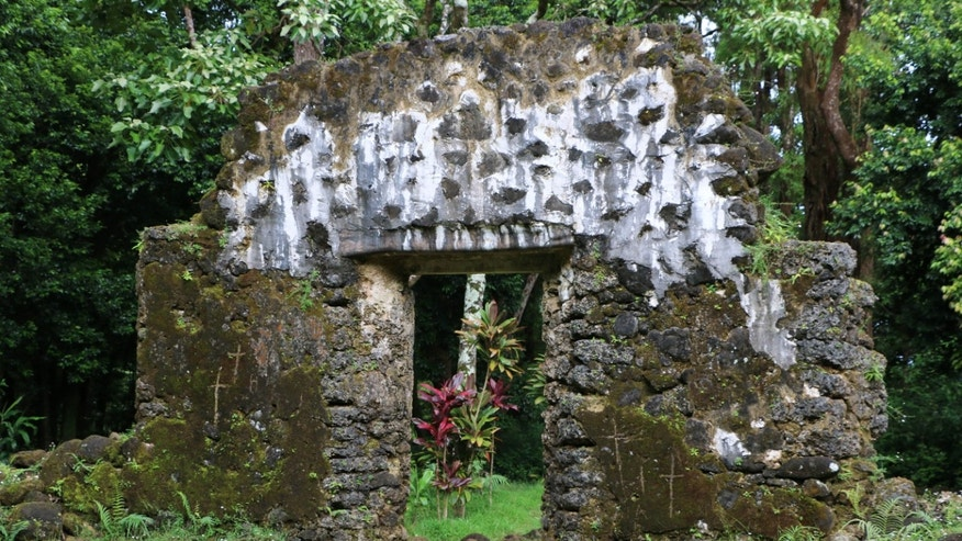 This undated photo, provided by the Hawaii Department of Land and Natural Resources, shows the crumbling remains of the 180-year-old summer palace of former King Kamehameha III where vandals etched crosses in the forest of a Honolulu, Hawaii, neighborhood.