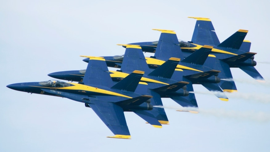 FILE: Members of the U.S. Navy Blue Angels precision flying team rehearse at Little Rock Air Force base in Jacksonville, Ark.