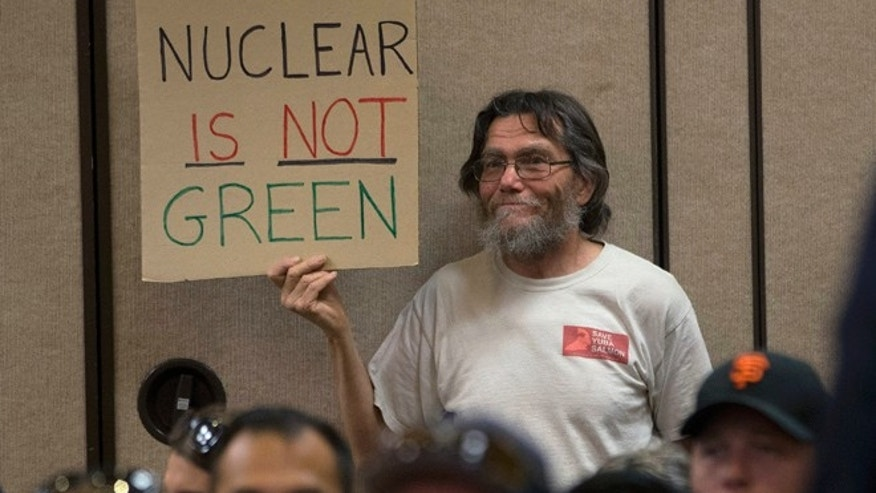 Peter Galbraith displays his opposition to a proposal to waive an environmental review of the Diablo Canyon Nuclear Power plant before renewing the plant's license, Tuesday, June 28, 2016, in Sacramento, Calif. (AP Photo/Rich Pedroncelli)