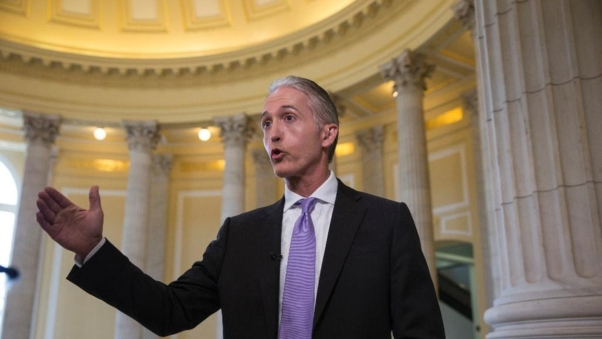 House Benghazi Committee Chairman Rep. Trey Gowdy, R-S.C., gestures during a TV news interview with MSNBC, on Capitol Hill in Washington, Tuesday, June 28, 2016, to discuss the release of his final report on the 2012 attacks on the U.S. consulate in Benghazi, Libya, where a violent mob killed four Americans, including Ambassador Christopher Stevens. (AP Photo/J. Scott Applewhite)