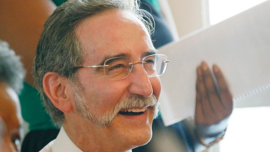 "FILE - In this June 15, 2014 file photo, David Goodman, the brother of Andrew Goodman, one of three civil rights workers killed in the ""Mississippi Burning"" case of 1964, laughs during a commemorative service for the three men at Mt. Zion United Methodist Church in Philadelphia, Miss. Recently, Goodman said it's wrong to only focus on the Klansmen involved in the killings, or even on Neshoba County. He said a society-wide reckoning with racism is still needed. (AP Photo/Rogelio V. Solis, File)"