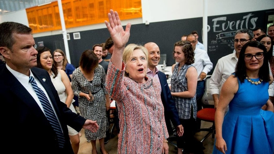 Democratic presidential candidate Hillary Clinton waves to workers while visiting Galvanize, a work space for technology companies, in Denver, Tuesday, June 28, 2016. While there Clinton said the House Benghazi committee found nothing different than previous investigations into Benghazi. (AP Photo/Andrew Harnik)