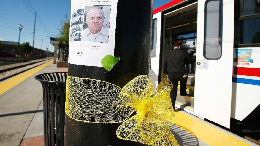 "FILE - In this May 18, 2016, file photo, a yellow ribbon is tied below a photo of Utah Transit Authority employee Kay Porter Ricks at the UTA Trax Ballpark station in Salt Lake City. A father and son on the run from police after tying up five women in a Utah basement abducted and killed a rail line worker, Wyoming prosecutors said Tuesday, June 28. The Lincoln County Attorney's Office charged Flint Wayne Harrison and his son, Dereck James ""DJ"" Harrison, with first-degree murder and kidnapping in the death of Ricks.  (Jeffrey D. Allred/The Deseret News via AP)  SALT LAKE TRIBUNE OUT; MAGS OUT; MANDATORY CREDIT; TV OUT"