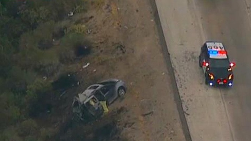 In this image made from video, a minivan burned on the side of Interstate 5, near the community of Gorman in Tejon Pass, about 65 miles north of downtown Los Angeles Tuesday, June 28, 2016.