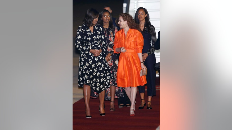 Morocco's King Mohammed VI wife Princess Lalla Selma, front right, welcomes U.S. first lady Michelle Obama, front left, and daughters Malia, rear right, and Sasha at Menara Airport in Marrakech, Morocco, Monday, June 27, 2016. The first lady is on a visit to Morocco to promote eduction for girls.  (AP Photo/ Abdeljalil Bounhar)