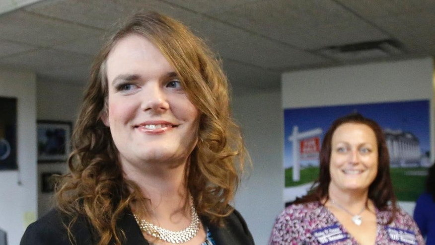 In this photo taken Tuesday, June 28, 2016, Democratic candidate for Senate Misty Snow speaks with a reporter in Salt Lake City. Snow is one of two transgender Democrats nominated for Congress in primaries in Western states on Tuesday, June 28, 2016. (AP Photo/Rick Bowmer)
