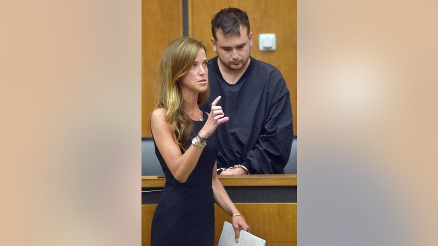 Patrick Riccardi-O'Connor, right, of Stoneham, Mass., stands as his attorney Andrea Levy speaks on his behalf during his arraignment Wednesday, June 29, 2016, in Woburn, Mass., District Court, on charges he fatally shot his firefighter friend David Atherton while playing with a handgun Tuesday night. Riccardi-O'Connor pleaded not guilty. (Patrick Whittemore/Boston Herald, Pool)