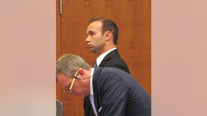 Former Ohio State University drum major instructor Stewart Kitchen, background, stands next to defense attorney Thomas Hayes in a Franklin County courtroom while being sentenced to three years in prison for sexual battery on Wednesday, June 29, 2016, in Columbus, Ohio. Kitchen, who was accused of raping a female student, pleaded guilty to sexual battery and apologized to the victim in court. (AP Photo/Kantele Franko)
