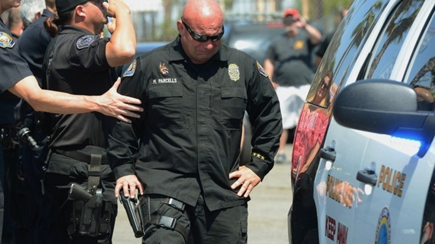 June 28: Long Beach Police Department K9 Officer Mike Parcels grieves after escorting the body of his LBPD K9 dog partner Credo from the Signal Hill Pet Hospital in Long Beach, Calif.