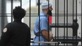 Adnan Syed enters Courthouse East in Baltimore prior to a hearing on Wednesday, Feb. 3, 2016 in Baltimore. The hearing, scheduled to last three days before Baltimore Circuit Judge Martin Welch, is meant to determine whether Syed's conviction will be overturned and case retried.
