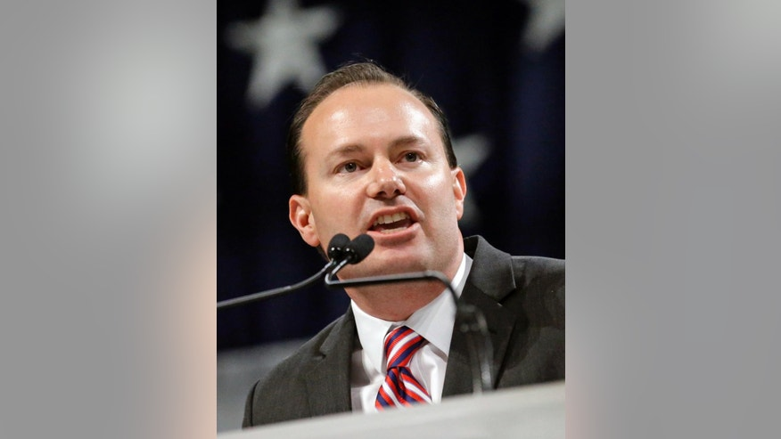 FILE - In this April 23, 2016, file photo, U.S. Sen. Mike Lee, R-Utah, speaks during the Utah Republican Party nominating convention in Salt Lake City. Utah voters will make their choices in a range of primary races Tuesday, including the battle for the Republican nomination for governor, a Democratic U.S. Senate contest and a GOP U.S. House matchup. (AP Photo/Rick Bowmer, File)