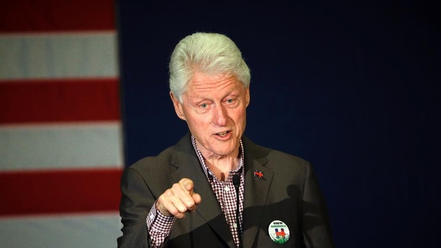 In this photo taken May 5, 2016, former President Bill Clint speaks in Portland, Ore. while campaigning for his wife, Democratic presidential candidate Hillary Clinton.  The former president spoke with Attorney General Loretta Lynch during an impromptu meeting in Phoenix, but Lynch says the discussion did not involve the investigation into Hillary Clinton's email use as secretary of state. (AP Photo/Don Ryan)