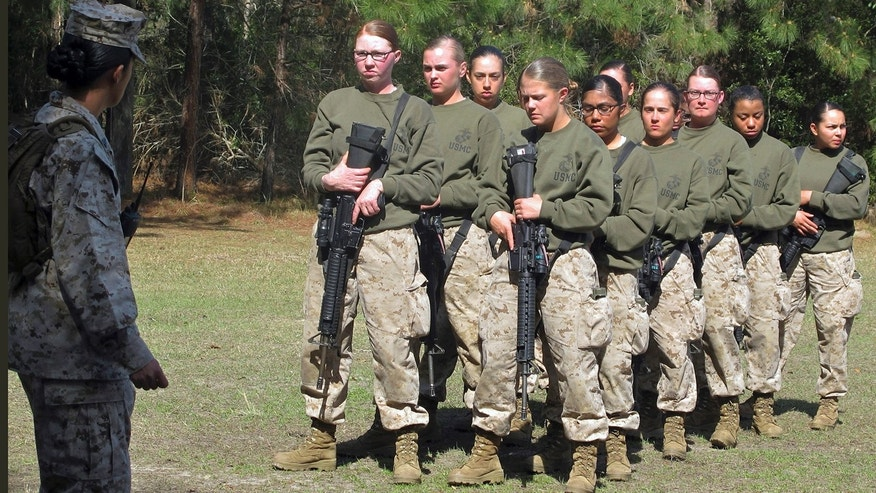 In this Feb. 21, 2013 file photo, female recruits stand at the Marine Corps Training Depot on Parris Island, S.C.