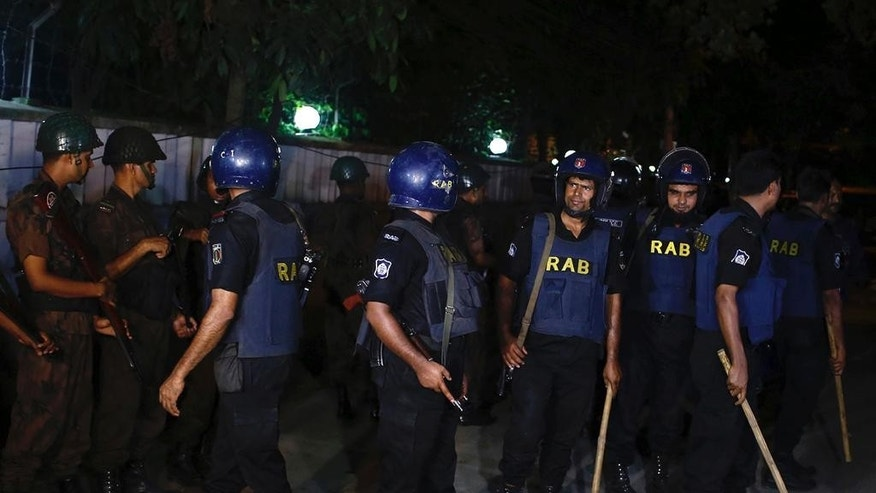 Bangladeshi security personnel cordon off the area after a group of gunmen attacked a restaurant popular with foreigners in a diplomatic zone of the Bangladeshi capital Dhaka, Bangladesh, Friday, July 1, 2016. A group of gunmen attacked a restaurant popular with foreigners in a diplomatic zone of the Bangladeshi capital on Friday night, taking hostages and exchanging gunfire with security forces, according to a restaurant staff member and local media reports. (AP Photo)