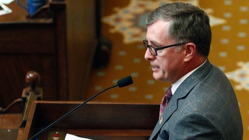 FILE - In this April 4, 2016 file photo, State Rep. Jay Hughes, D-Oxford, calls on fellow lawmakers to vote against House Bill 1523, on the chamber floor at the Capitol in Jackson, Miss.  Hughes says Speaker Philip Gunn violated the state constitution by setting a computer voice at a superfast speed to read bills aloud.  (AP Photo/Rogelio V. Solis, file)