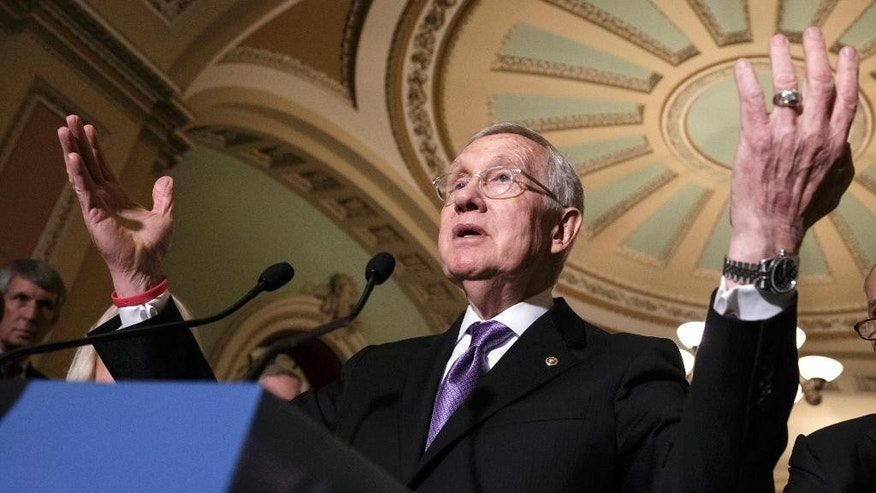 Senate Minority Leader Harry Reid of Nev speaks in Washington, Tuesday, June 28, 2016. A year after South Carolina removed the Confederate flag from its capitol grounds, official Washington is struggling with further restrictions on the flag's display on federal property, including the U.S. Capitol complex. (AP Photo/J. Scott Applewhite)