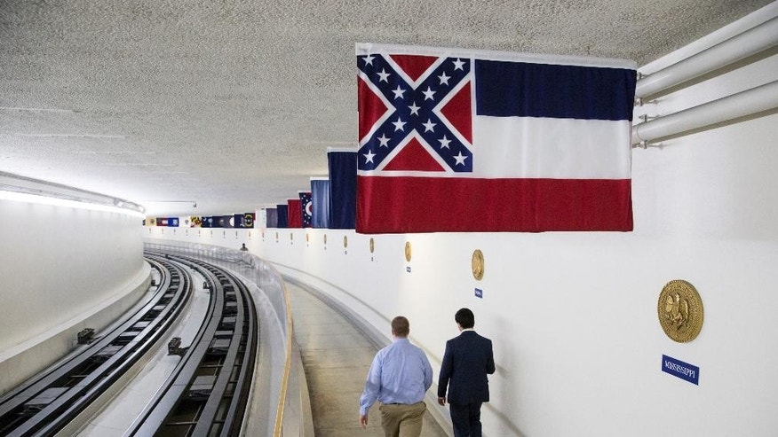 The Mississippi state flag is displayed with the banners of other American states, territories and commonwealths, above a walkway in the tunnel from the Capitol Building to the Dirksen Senate Office Building in Washington, Friday, July 1, 2016. The flag is unique among U.S. state flags as it is the only one which still depicts elements of the Confederate battle flag. A year after South Carolina removed the Confederate flag from its capitol grounds, official Washington is struggling with further restrictions on the flag's display on federal property, including the U.S. Capitol complex. (AP Photo/J. Scott Applewhite)