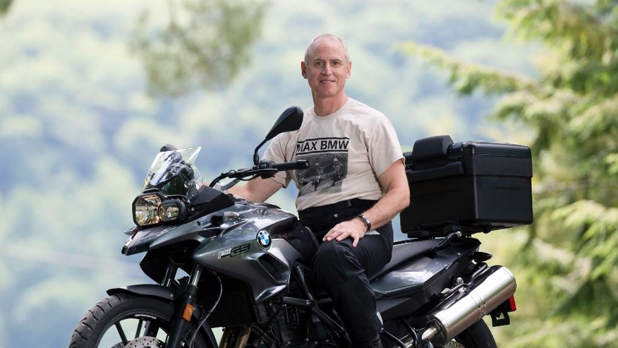 In this Thursday, June 23, 2016 photo, Dan Ruderman poses on a motorcycle at his home in Great Barrington, Mass. Ruderman plans to join a cross-country motorcycle trip to celebrate the 1916 trip made by his grandmother Adeline Van Buren and her sister Augusta Van Buren. (AP Photo/Mike Groll)