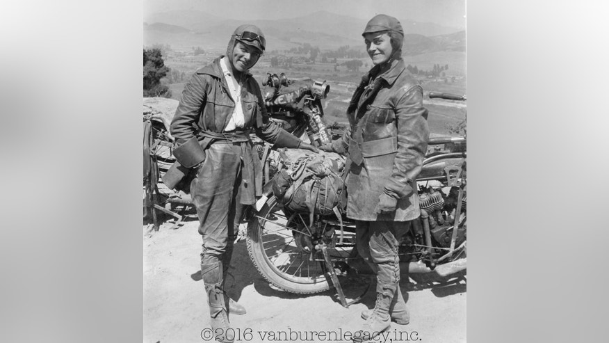 This 1916 photo provided Dan Ruderman shows his grandmother Adeline Van Buren, right, and her sister Augusta Van Buren, in Los Angeles during their cross-country motorcycle trip. A century ago, when the automobile was in its infancy and most roads in the United States weren't paved, the intrepid sisters from Brooklyn embarked on a remarkable journey, a 4,000-mile trek across the country, aboard two Indian motorcycles. (Courtesy of Dan Ruderman via AP)
