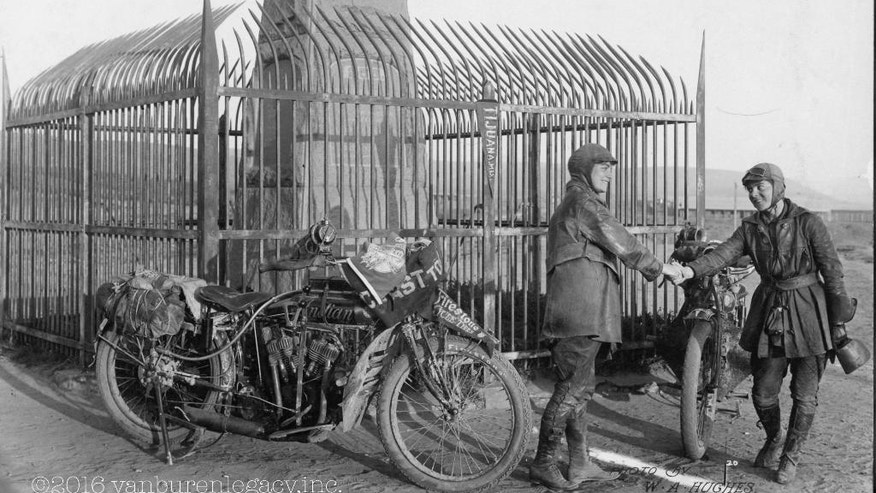 This 1916 photo provided Dan Ruderman shows Adeline and Augusta Van Buren at the United States/Mexico border during their cross-country motorcycle trip. A century ago, when the automobile was in its infancy and most roads in the United States weren't paved, the intrepid sisters from Brooklyn embarked on a remarkable journey, a 4,000-mile trek across the country, aboard two Indian motorcycles. (Courtesy of Dan Ruderman via AP)