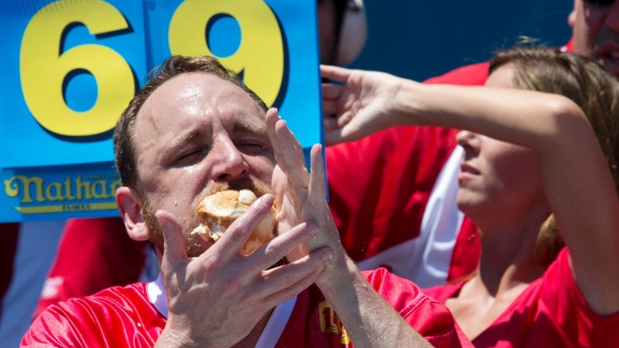 Joey Chestnut wolfing down hot dogs.